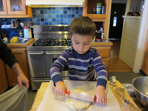 Finn rolls out the dough