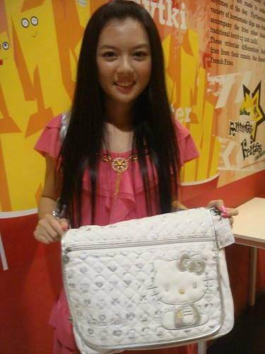 Chee Li Kee with Hello Kitty bag