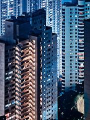 Hong Kong facades (miemo) Tags: china city travel autumn windows urban abstract building fall wall architecture night skyscraper hongkong lights asia exterior olympus balconies tall hongkongisland ep1 omzuiko100mmf28