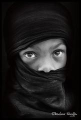 Looking to my Eyes ! (Bashar Shglila) Tags: boy eyes child libya tuareg libyan ليبيا daraj درج ghadamis غدامس طوارق ليبي tagelmust توارق bestportraitsaoi تارقي ☆thepowerofnow☆ mygearandmepremium mygearandmebronze mygearandmesilver mygearandmegold mygearandmeplatinum