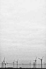 spot the fake Eiffel Tower (Janey Kay) Tags: sea england blackandwhite mer blancoynegro beach sussex kent december noiretblanc foggy windmills explore angleterre sep schwarzweiss plage brouillard englishcountryside 2010 dcembre electricitypilons ventilateurs sigma2470mm28 janeykay niksilverefexpro paysageanglais nikond300s windfarmineastsussex