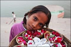 Offerings - Varanasi, India (Maciej Dakowicz) Tags: city india flower girl person asia child varanasi kashi ganga ganges offerings benares
