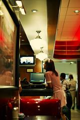 Diner Mood (Chris JL) Tags: red woman usa color reflection night lights photo airport uniform mood texas candid georgebush profile streetphotography houston diner rubys waiter iso1600 photoderue spnp photographiederue fotografíadecalle fotografiadistrada nikkor50mmf14g nikond3s chrisjl dwcffstreet