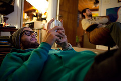 Taylor (BurlapZack) Tags: beard glasses hoodie livingroom iphone dentontx watchingamovie canonef28mmf18usm canoneos5dmarkii twobeards panectorhouse phonetwiddlin