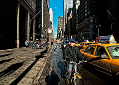 Fifth Avenue, New York City (mudpig) Tags: street nyc newyorkcity shadow newyork man clock car geotagged cityscape cab taxi yellowcab stranger delivery mudpig stevekelley