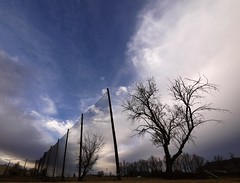 Fence Lines (Ph0tomas) Tags: trees winter storm newmexico net beautiful clouds landscape lumix g dramatic surreal g1 netting f4 socorro vario 714mm ph0tomas