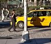 Shadow Hail (John Fraissinet) Tags: nyc newyorkcity shadow ny newyork hail fence hotel cab taxi streetphotography cobblestone gesture bellhop hailing johnfraissinet streetobservationscom