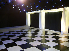 Dance floor hidden behind a reveal by county marquees, on Flickr