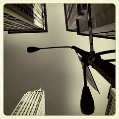 Up in Downtown (street level) Tags: city nyc newyorkcity travel urban newyork building art architecture downtown skyscrapers manhattan lamppost gothamist lowermanhattan iphone