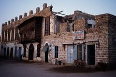 Old town of Massawa (Frhtau) Tags: africa street old people building history shop square town war market harbour culture scene east afrika reconstruction massawa eritrea architekture demolution