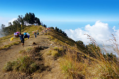 Sembalun Rinjani camp site (sydeen) Tags: blue outdoor hiking cloud lombok indonesia grass people top clouds savana tent mountain sky nature camping landscape sembalun hiker pelawangan plawangan