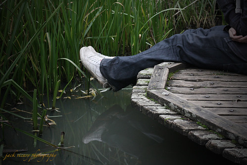 wood blue colour reflection feet reeds pond hands shoes mr ripped platform dirty jeans hanging dye dangling vignette laces jackvicary