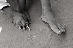 African Childhood Games (Planet Love) Tags: africa blackandwhite game feet sand hands child orphan orphanage uganda eastafrica pader northernuganda kitgum warchild blackchild waraffected aidsorphan