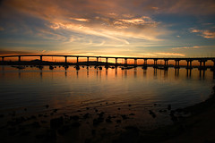 San Diego- Coronado Bridge (wyojones) Tags: california reflection sunrise boats sandiego np silhouttes sandiegobay wyojones coronadolowlandspark sandeigocoronadobridge