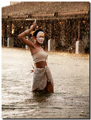 Traditional Thai Sunset Dance (Jikesh k) Tags: sunset vacation reflection water pool rain club marriott thailand hotel dance traditional dancer thai phuket jwmarriott olmpus anawesomeshot e520 jikesh