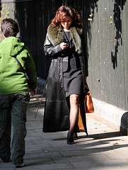 Asian woman walking and Texting () Tags: street city uk greatbritain vacation england woman holiday sexy london stockings westminster fashion walking asian calle nikon highheels phone fitzrovia