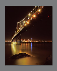 Threshold (RZ68) Tags: sanfrancisco city bridge reflection water skyline night buildings reflections island lights golden bay gate san francisco long exposure cityscape treasure treasureisland no under calm velvia baybridge yerba provia buena yerbabuenaisland e100 flickrsbest rz68