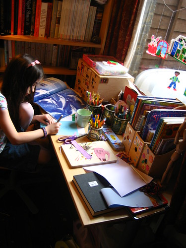 Drawing at her desk