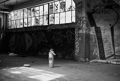 Extinguish (andrewallenmoore) Tags: blackandwhite bw white black abandoned delete10 delete9 delete5 fire graffiti delete2 berkeley paint shadows delete6 delete7 delete8 delete3 can delete delete4 spray lsd warehouse extinguisher tfn hellyeahbrother deletedbythehotboxuncensoredgroup