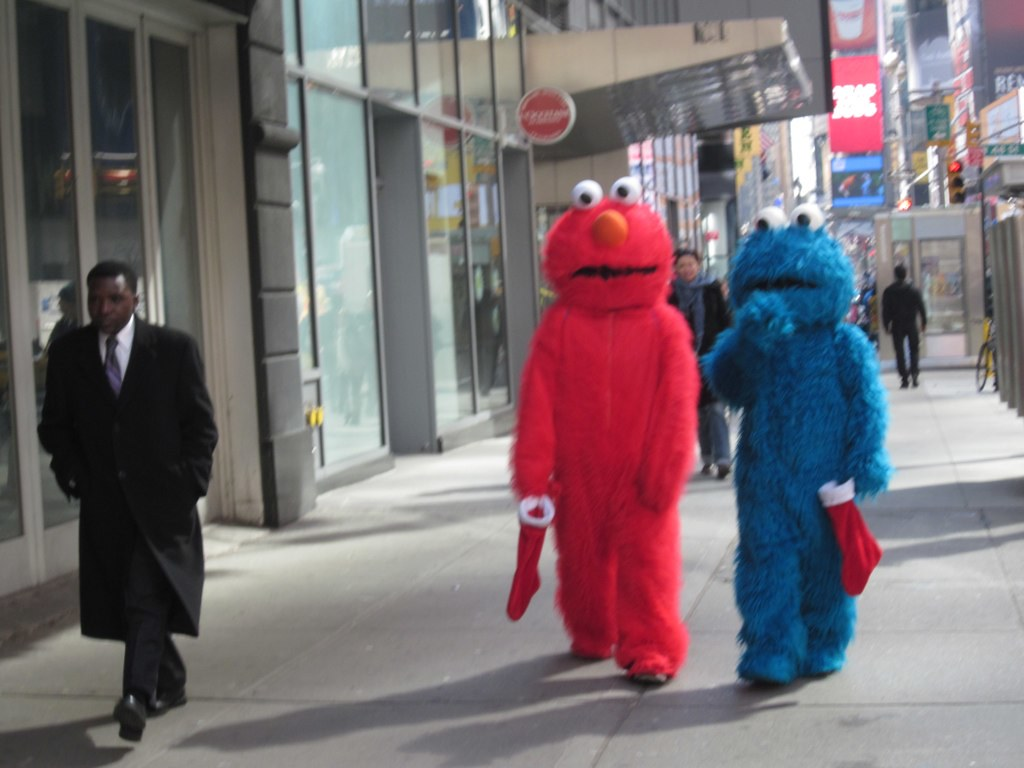 Elmo and Cookie Monster visit Times Square