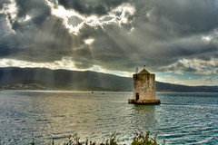 Sun finds its way - Stormy clouds over the lagoon (HDR) (luigig75) Tags: sea sun lake clouds canon lago god stormy lagoon rays f4 hdr 1740 orbetello argentario justclouds canon1740mmlf4 mygearandme mygearandmepremium mygearandmebronze mygearandmesilver