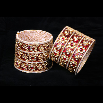 01 A pair of gold, enamel and gem set cuff bracelets