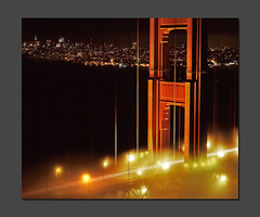 Embrace the Amber Glow (RZ68) Tags: sanfrancisco city bridge light sky cars film fog skyline night mediumformat lights golden bay gate san francisco long exposure glow cityscape traffic foggy trails line velvia goldengatebridge goldengate glowing 6x7 streaks provia ggb e100 rz68