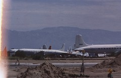 Douglas C-118A Liftmaster (DC-6A) unidentified, USA - Air Force, Tucson - Davis-Monthan AFB,  July 29 1984. (ATom.UK) Tags: amarc dc6 c118