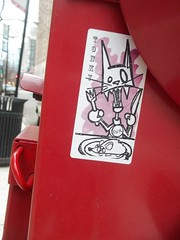 tonky (VVVvoy) Tags: red chicago eye stand sticker kitty evil tonky