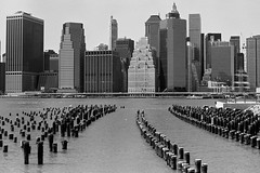 Lower Manhattan from Brooklyn Bridge Park (Shawn Hoke) Tags: nyc bw film brooklyn cityscape skyscrapers manhattan developer eastriver nikonf3 lowermanhattan kodaktrix400 nikkor50mmf14ai epsonv500 kodakxtoldeveloper shawnhoke believeinfilm