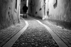 gorizia stalker (i k o) Tags: blackandwhite bw night canon geotagged eos alley dof darkness bn explore stalker vignetting uphill vicolo notte ef50mmf18ii biancoenero gorizia salita vignettatura 450d tenebra buttha viacocevia theauthorsplaza theauthorsclub