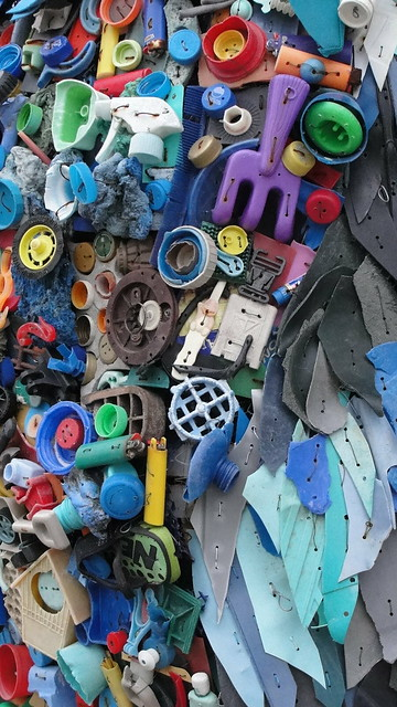 detail of a sculpture made from debris found on a beach