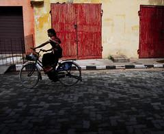 Pondicherry bike (Rick Elkins) Tags: street woman india girl bike bravo candid cobblestones riding transportation tamilnadu pondicherry anawesomeshot
