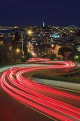 Lights of Lombard, SF, Ca (Jared Ropelato) Tags: sf sanfrancisco california city longexposure trip travel light wild vacation sky urban lake tree nature beautiful leaves clouds creek canon landscape lights evening leaf site spring rocks crash outdoor tripod scenic trails illumination laketahoe visit scene hike cliffs adventure boulders trail filter lighttrails wilderness curve shrubs rugged lombard paintedladies illuminate manfrotto 2010 lansdscape crick giotto cablerelease 2011 1635mm waterrocks singhray greenlush 5dmkii jaredropelato ropelatophotography