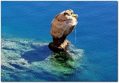 Weathered (n.pantazis) Tags: blue sea color green weather rock aquamarine cyan greece weathered ripples breeze corrosion corroded loutraki pentaxkx calmsea heraion iraion corinthiangulf solitaryrock dal50200 solitaty