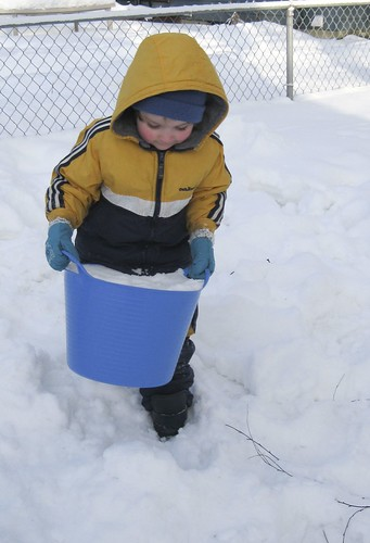 carrying a bucket of snow
