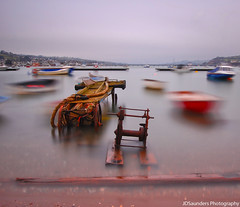 Isolation (JDSaunders Photography) Tags: wood old morning bridge sea england motion blur beach water wheel metal river boat movement nikon rust long exposure cloudy stones jetty south rustic platform overcast vessel pebbles devon impressionist buoy pontoon dinghy density neutral teignmouth d40 nd110