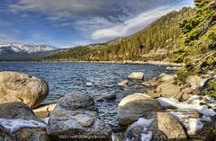 Lake Tahoe #1 (C. Roy Yokingco) Tags: travel blue sunset usa lake snow mountains cold water photography nikon rocks waves cloudy nevada