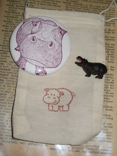 hippo pinback button, mini hippo, and linen bag