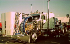 PETERBILT WITH BLUE FLAMES (NOMAD ETERNUS) Tags: tractor ford truck florida semi firetruck international chevy chrome semitruck peterbilt kenworth overtheroad louvers truckshow customtruck stakebody chromewheel wildwoodflorida petelabarbera