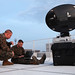 Marines set up a satellite system for Operation Tomodachi