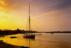 Maldon on the coast of Essex, England. (jimj0will) Tags: uk greatbritain sunset england orange beach church water reflections river golden coast boat waves sailing ship britain shore mast essex litoral rigging literal maldon digitalcameraclub countyofessex alltypesoftransport 100commentgroup jimj0will jimjowill