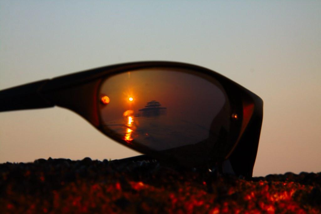 Sunglass sunset reflection