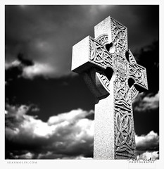 Cros Cheilteach *Explored* (Sean Molin Photography) Tags: blackandwhite bw 6x6 film cemetery grave graveyard clouds rollei rolleiflex mediumformat square indianapolis headstone tombstone dramatic highcontrast indiana negative scanned granite limestone infrared april marker mf filmcamera celticcross gravesite redfilter filmgrain crownhill 2011 developedathome fujineopanacros kodakhc110 rolleiflex35fplanar crownhillcemetery fujifilmneopan100acros centralindiana film:brand=fuji film:iso=100 developer:brand=kodak developer:name=kodakhc110 film:name=fujineopanacros100 filmdev:recipe=6506