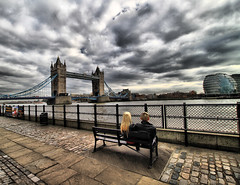 Romantic London (` Toshio ') Tags: greatbritain bridge boy england woman sun storm man building tower water girl thames architecture clouds towerbridge river bench boat couple europe unitedkingdom stormy romantic hdr highdynamicrange embankment europeanunion thamesriver toshio