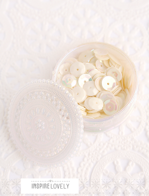 i love the little doily looking container xo