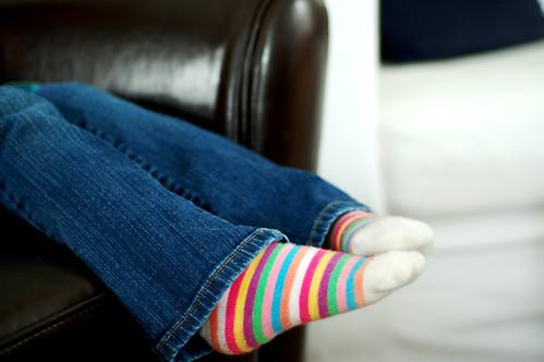 Relaxing in stripey socks.