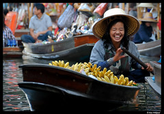 The laughing bananamerchant (Dan Wiklund) Tags: woman laughing thailand canal asia southeastasia bananas d200 floatingmarket damnoensaduak 2011 camoe