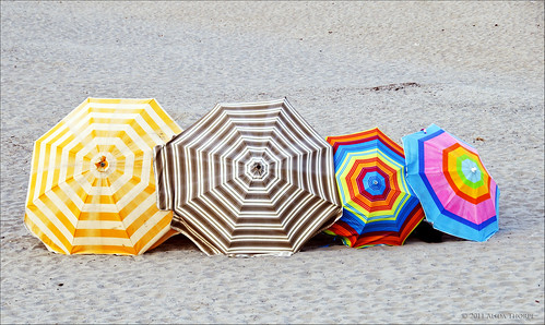 beach umbrellas by Alida's Photos