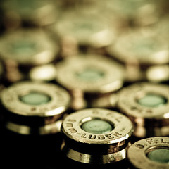 9mm Luger (Bright Lights, Vegas Nights) Tags: macro canon square eos dof bokeh ammo ammunition 9mm luger parabellum canonef100mmf28macrousm rebelxs 1000d